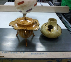 HOLLOW FORM AND NATURAL FORM LIDDED BOX WITH FEET BY RICK PIXLE