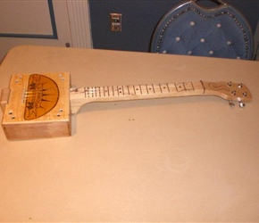 CIGAR BOX GUITAR BY JOAN NICHOLS