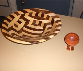 SEGMENTED BOWL BY TOM MILLER AND BOWL WITH FEET THAT TOM MADE IN HONOR OF RAY  FEET ROBERTS