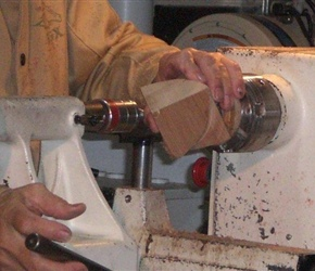 03 PLACING TRIANGLE INTO JIG TO FINISH TURNING .jpg